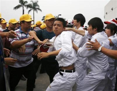 2010-05-31-honda-workers.jpg